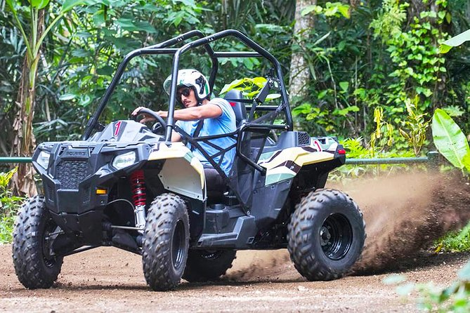 """Have ATV rides for your Bali adventure tours with Bali ATV Jungle Buggy Adventure! With Buggies Bali Ride, driving through the jungle with the best and high-end ATV buggy. Definitely will make you thrilled! Start your engine to explore a new track of """"ATV purpose-built"""". You will pass through 4.5 km over each lap and it becomes the first and the only """"ATV purpose-built"""" track in Bali. Using a different kind of ATV vehicle, it offers you a thrilling and intense driving experience. You can also choose a package you want to use: 1 ride only you, double with your partner, or if you don't have any valid driving license the instructor will be ready accompanied you. Let's get started!"""