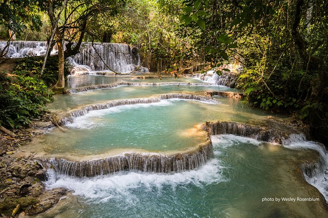 Kuang Si or Kouang Si Waterfall is one of the highlights of Luang Prabang. A single large cascade tumbles from the jungle feeding a series of falls and pools that make perfect swimming holes. Visiting Phosi Market on the way to Kuang Si Waterfall you will have a great chance to experience the local life in the market.