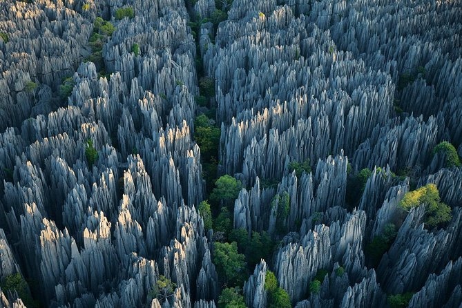 One fear of many travelers in China is unmistakably crowds. And yes, also the Stone Forest at first sight might be suffering from commercialized tourism, but don't let this hold you back from visiting. Both the Stone Forest and Jiuxiang caves are big areas and our tour guides know the right places to avoid the masses. Whether you want to find the best spots to shoot great pictures or have a peaceful stroll without being disturbed, you'd be surprised what Yunnan has to offer! With our guides you also never need to wait in line to buy tickets so you can make the best of your time.