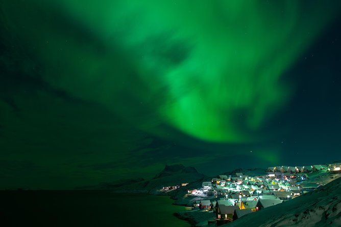 Chase the dancing Northern Lights and explore every corner of Greenland's capital city on this 2-hour nighttime tour in Nuuk.<br><br>Join us as we drive you to the darkest places in the city for panoramic views of one of the highlights of the Arctic winter. During the tour, your local guide will tell you a little about Nuuk and the Northern Lights, and is always happy to answer your questions about Greenland.<br><br>Unavoidable fact: it is likely to be chilly. It is the Arctic winter after all! Our transportation is heated and you can always retreat inside if you get too cold, but make sure you bring heavy outer layers, a woollen hat, scarf, and gloves/mittens so you can stay outside as much as possible. We will also warm you up with a hot chocolate during the tour.<br><br>It is important to remember that the Northern lights are unpredictable and may not appear during the tour. If you are unlucky and don't get to see them on the tour, we will rebook you on another night for FREE!<br>