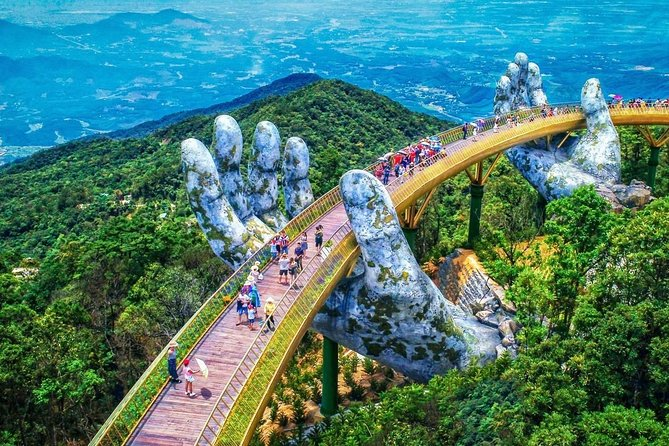 Experience Vietnam's Ba Na Hills theme park on this guided excursion. After a convenient hotel pickup, catch picturesque views of Da Nang City from the Golden Bridge, located 1,414 meters (4,593 feet) above sea level, catch a cable car that bills itself as the longest in the world, explore French Village and Fantasy Park, take in a classical concert, and enjoy a delicious complimentary lunch and beer.<br>