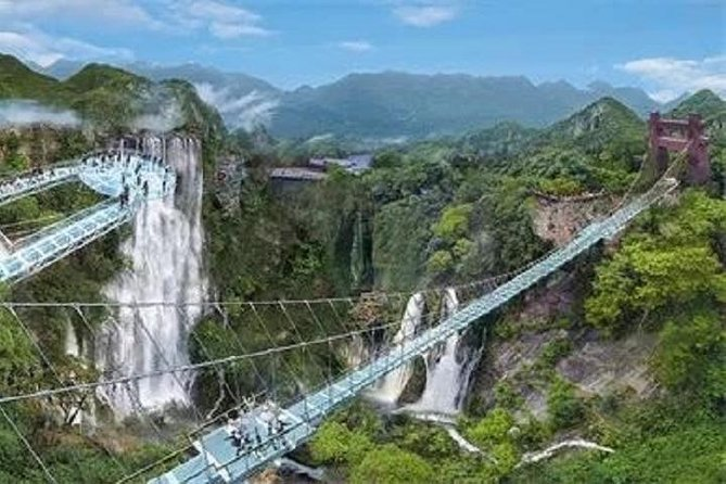 This day trip will let you explore the north outskirt of Guangzhou, immerse in the beautiful landscape in the countryside and escape the bustle city. Based on your interest, you can choose 2 places of interest to visit for this tour from the 4 options below:<br><br>1) Gulong Canyon, climb adventure tracks, see big waterfalls in the mountain and walk onto the Grand Glass Skywalk Bridge to overlook the impressive subtropical mountain&valley.<br><br>2) Hotspring Spa Resort, for bathing and relaxing your body in the natural hotspring pools with different flower essence or Chinese herbal medicine ingredients.<br><br>3) Forest Peaks Corridor, for beautiful delicate small mountains landscape viewing and cycling ride for fun.<br><br>4) Jinlong Cave, fantastic natural miracles for boat ride and walking into the exquisite cave.<br><br>The above 4 sites are relatively close to each other located to the north of Guangzhou around 2 hours driving, visiting 2 of them would compose a 9 hours day trip.<br><br>Suitable for adult and kids.