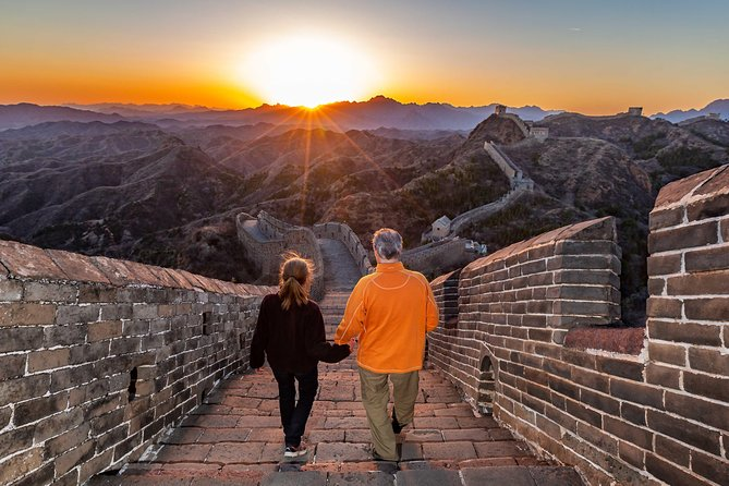If you are not a morning person, or if you are a shutterbug, this private sunset Great Wall tour is surely a good choice for you. The tour starts at 11:00 am, and you will have a chance to enjoy the most amazing Sunset on both Gubeikou and Jinshanling Great Wall.<br>The view by the sunset is outstanding!