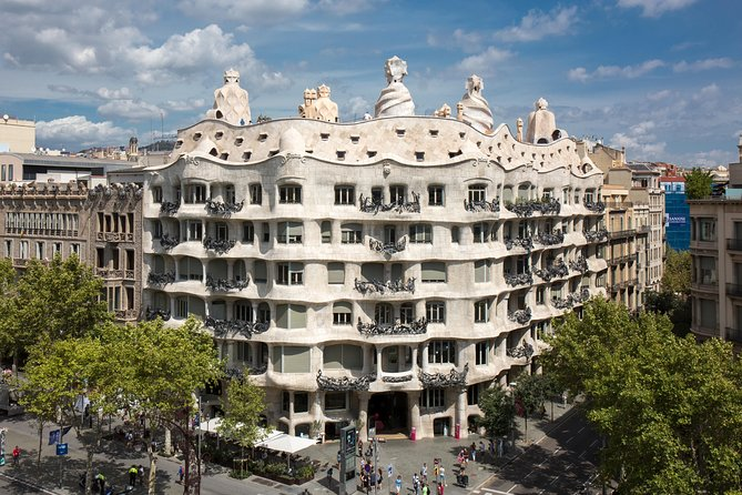 Explore La Pedrera — otherwise known as Casa Milà — one of Gaudi's most iconic Barcelona buildings, on this 1.5-hour skip-the-line audio tour. Walk through the entrance reserved for skip-the-line ticket holders, and view the interior of this early 20th-century masterpiece at leisure, as an audio guide chronicles the architect's vision and building's construction. View the spiraling chimneys of the Warrior Rooftop and enjoy the best panoramic views of Barcelona; learn about Gaudi's life at the Gaudi Space in the amazing Whale Attic; see a recreated Gaudi-designed apartment; visit the courtyards, a true spectacle of light, shapes and colours. <br><br>Did you know that Casa Milà is also a Foundation? Catalunya La Pedrera Foundation serves society to build a better and fairer future within a framework of direct quality, excellence and innovation. The Foundation enable more than 500.000 people to have a better and fairer future.