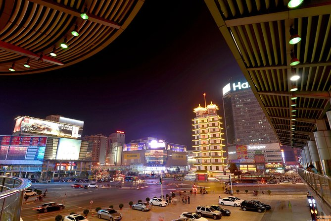Discover Zhengzhouat night on a 3-hour private tour. Following a hotel pick up, accompanied by your private tour guide to stroll around the shops and restaurants around Erqi Square which is thebusiest commercial area. Admire theErqiMemorial Tower and get toknow its history and background. Then, walking through bustling markets and snack street. Get a glimpse of local life as you browse differentstalls and practice yourhaggling skills.This private night tour includes English speaking tour guide and private vehicle, Zhengzhou city hotel pick up and drop off.