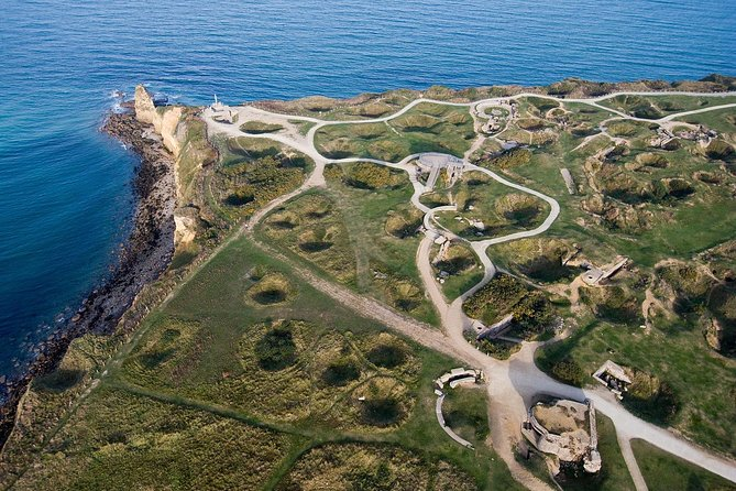 Visit to Normandy D-Day battle sites and U.S landing beaches from Paris<br><br>See the 100 feet high cliffs and german bunkers overlooking the British channel at Point du Hoc<br><br>Walk along the Bloody Beach (Omaha)<br><br>Visit the American War Cemetery<br><br>Discover the pretty little town of Arromanche and the vestige of the artificial port<br><br>Step back in time on a history tour, and learn about the events of June 6, 1944<br><br>Visit the Caen Peace Memorial and german general « Von Richter » Communications center & headquaters underneath bunker