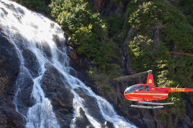 This 30-minute flight is a combination of our two best tours, Mahoney Falls and Top of the World. You will fly out to a 1500 foot waterfall, with the possibility of seeing mountain goats. Then fly along the George Inlet and up to our exclusive helipad on an 1800 foot mountain with views of the Canadian Rockies and Prince of Wales Island. You will stay on the helipad for 10 - 20 minutes to take pictures and enjoy your surroundings. The remainder of the 30-minute flight flies over the Tongass Narrows, Ketchikan, and the cruise ships.