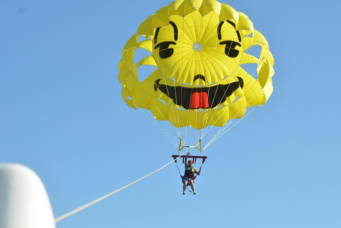 Be picked up from your hotel in Hurghada by a representative and then transferred to the Marina.<br><br>Take part in parasailing, a recreational activity where a one or two people are towed behind a boat while attached to a parachute, ascending up to 40-50 meters (about 164 feet) in the air with a full 10-13 min flight time. For this activity, no training is required. Your friendly and experienced captain and crew will do all the work to ensure your comfort and safety. Choose to fly single or two people at a time.<br><br>Know that your safety is the number one concern; both captain and crew are CPR and Advanced First Aid Certified and all parasailing equipment is regularly inspected and certified.