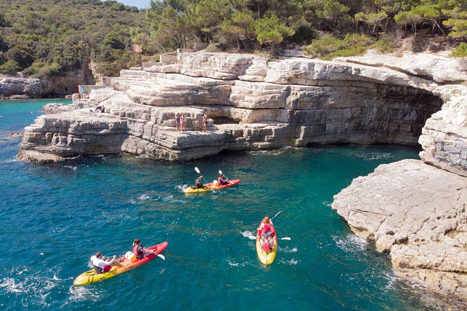On this 3-hour, small group Kayaking Adventure tour our friendly guides will take you on a FUN filled paddling to the Pigeon cliffs and Muzil peninsula where you'll explore sea cave and underwater world just a few feet under the surface. Also, the brave ones will have the opportunity to try the exciting cliff jumping, a popular summer FUN activity and fantastic sight.<br><br>- Enjoy kayaking in small group, max 12 kayakers<br>- Explore beautiful coves & hidden beach by kayak<br>- Snorkel into sea cave & search for amazing underwater creatures<br>- Try exciting cliff jumping from Pula's highest cliffs<br>- Find out FUN & interesting facts about Pula's history & ecology<br>- Get amazing underwater GoPro photos & videos<br>- Refresh with Ice-cold soft drinks & seasonal fruits during the tour <br>
