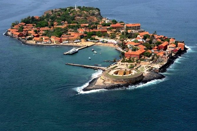 Although the history of Gorée island is rather dark , with the major role the island played in the Atlantic slave Trade , this former slave port is now a gem of Senegal . Our clients will enjoy a pleasant 15 min ferry ride to the island , where they will tour the slave house , the famous art , studio , museum , and the koumba castle .