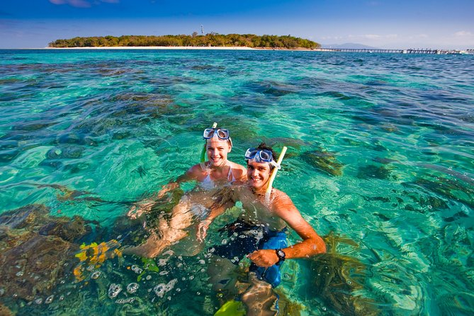 Cruise to Green Island from Cairns and find a tropical paradise on the Great Barrier Reef. You'll spend either four or five hours at Green Island, with plenty of time to snorkel or scuba dive, tour the reef on a glass-bottom boat or view coral from a semi-submersible submarine.