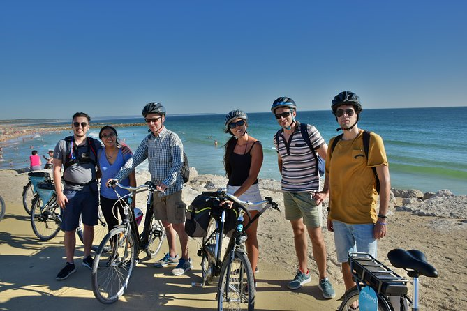 Ready for an unforgettable electric bicycle tour alongside the Atlantic Coast? <br><br>Our guides will lead you through a very authentic experience along the most beautiful fishing villages of Lisbon. <br><br>This is activity is the oldest one we have and was our departure point to find and start developing a community-based tourism initiative in Trafaria and Costa da Caparica regions! <br><br>Since we started, we had many opportunities from it and have created very good relationships with our beloved community: that´s why we exist and are here!<br><br>With a duration of3 hours, we will enjoy a soft ride, completely out of the beaten paths and the best way to get know this genuine area and its people. <br><br>It´s not only a bicycle tour, it´s a lifetime experience for all - you, our visitor, and for the locals, our treasure and best part of the whole adventure.