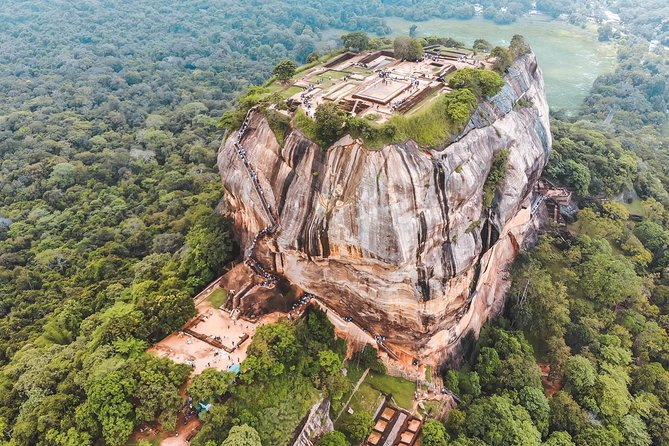 Private Sigiriya and Dambulla Day Tour<br><br>You will be starting your tour at morning from your hotel or Airport, where you will be picked up your chauffeur. Ensure that you bring a packed breakfast with you if you are unable to have your meal at the hotel.<br>• Lion's Rock : This is a 220 metre high rock, at the top of which an ancient King built his Palace. In addition to being a well maintained model of ancient urban life, Sigiriya is also an adventure of rock climbing for many.<br>• Village Tour : Enjoy a Bullock Cart Ride while enjoying sightseeing of the rural village life with phase of adventure will be a Catamaran ride at the scenic lake. Finally, enjoy Traditional Lunch at a local house prepared by the village women.<br>• Dambulla : It is home to an ancient cave Temple also known as the Golden Rock Temple, which is a popular tourist attraction.<br><br>