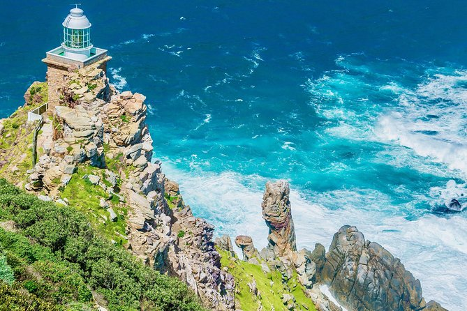 Includes the Cape Point Entry fee! Join us to enjoy a live-guided day excursion to visit the Penguins at Boulders Beach, Cape Point (the romantic meeting place of the mighty Atlantic and Indian oceans) and the Cape of Good Hope.<br><br>This tour offers you over 1 hour at the penguin beach, over 2 hours at Cape Point to fully explore this gem and Unesco Heritage site and another 30 minutes at the Cape of Good Hope. Lunch can be enjoyed at the Two Oceans Restaurant at Cape Point (at your own expense). You can also choose to join the optional, guided hike from Cape Point to the Cape of Good Hope (approx 40 minutes, requires medium fitness & good walking shoes).<br><br>After a day spent exploring, sit back in your seat and enjoy the coastal drive back to Cape Town via Scarborough and Kommetjie, with spectacular views from the Ou Kaapse Weg mountain pass. Free WIFI and USB charging stations available at your seat.