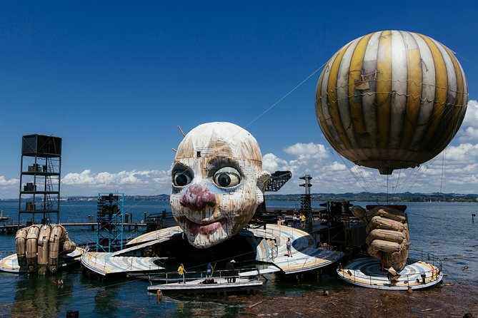 """Almost sold out <br>Best Tickets 1st Category available 08th of August - arrangement from 7th to 09th of August 2020 ! <br>Welcome to the Bregenz Festival """"RIGOLETTO"""" Opera in three acts from GIUSEPPE VERDI<br>3 day trip to Lindau , Bavaria Lake Constance <br>Our experienced, multilingual tour guides with excellent local knowledge, friendliness and reliability in a high degree to experience the Highlights of the lake Constance and its surroundings in a particularly pleasant way and to keep in memory <br>Exklusive Premier tickets for the festival on the largest floating stage in the world Enjoy this unique experience at the Open Air auditorium on the shore Lake Constance <br>1,5 hour sightseeing tour by boot on Lake Constance <br>In the afternnoon the festival ship departures right in front of your hotel and will take you directly to the stage in Bregenz .including a glass of Champagne. <br>Relax and enjoy this unforgettable Experience : <br>2,5 hour Opera """"RIGOLETTO"""" from Guiseppe Verdi """" on your reserved seats<br>"""