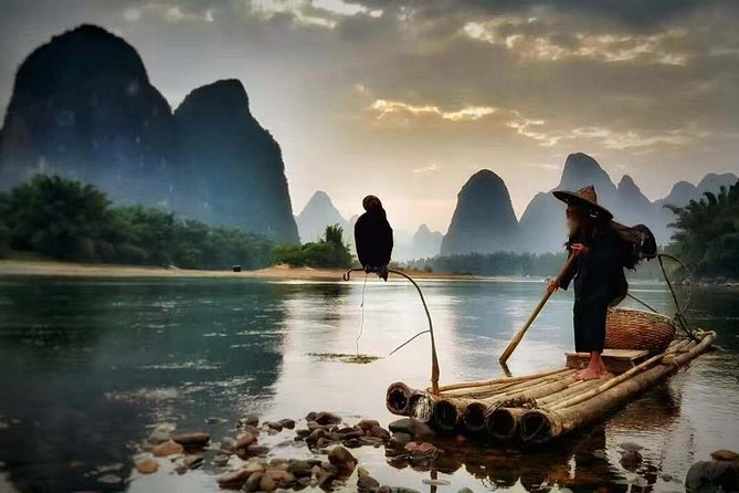 "The classic shot of Li River is the one called ""fishing lights on the Li River"", together with sunrise or sunset. In the past, local fishermen paddled their bamboo raft and went fishing on the Li River as night falls. A magical scene appears when the river is dotted with fishing lights. It's a scene that shows an intimate relationship between human and nature.  <br><br> Highlights: <br><br>1. Enjoy the Sunset of the 20RMB note area. <br><br>2.  take the photos with fishermen on bamboo rafts or even with the fishing birds. <br><br>Note: If you want to book this tour ONE day before, you'd better check with us if has a Fisherman available or not, due to sometimes the fishing man is fully booked, thank you."