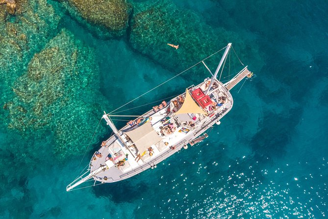 """Romantika"" and ""Kapetan Michalis"" Classic wooden Yachts sail daily at 10:00am on a cruise to the 3 most beautiful bays in Rhodes anchoring for 1 hour at each one. Sunbathe, swim and snorkel with your friends and family!<br><br>The first stop is Kallithea Springs, an ancient therapy spa. Next is the Caves of Traganou at Afandou Beach, where you can snorkel inside the rock formations. The third stop is Anthony Quinn Bay, a picturesque pirate shelter with abundant underwater life.<br><br>Enjoy a lunch buffet of Mediterranean, seafood and vegetarian dishes, prepared and served on board. The crew will keep your glass filled with chilled wine, cold beer or juice throughout the cruise."