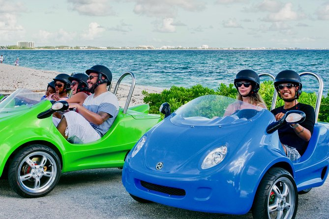 You will drive your own super cool three wheeled Scooter that navigates you to see the best attractions by way of GPS Tour. <br><br>The GPS App is full of history and information on Cayman which you will receive via tablet GPS as you drive along. You are free to stop for beach time, as well as visit any attraction stops you may choose. Or you can simply drive the tour route and enjoy the scenery and content of the app. You can customize your adventure on your own, making this far from your ordinary land tour. <br>