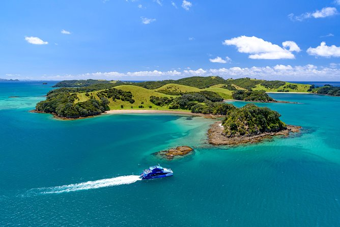 This is the most popular dolphin watching cruise in the Bay of Islands, and for good reason! Board your cruise in Paihia or Russell and take in the stunning views as we glide out through the islands and along the Rakaumangamanga Peninsula to Cape Brett, where a historic lighthouse keeps watch over and Piercy Island/Motukōkako, or as it is popularly known the 'Hole in the Rock'<br><br>Listen as your experienced crew share local history and ecology via an informative commentary, keep your eyes peeled for dolphins, whales, and other marine and birdlife as you cruise through and past many of the 144 islands that make up the Bay of Islands<br><br>Don't want the journey to end? Hop off in Russell or Paihia after your cruise for more exploring before using your complimentary Russell/Paihia ferry ticket to get back.