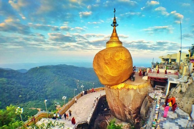 The Golden Rock is one of the most famous places to visit in Myanmar, we offer an affordable day-tour from Yangon to Golden Rock!<br><br>The day return trip to the Golden Rock near Kyaikhtiyo is one of the most revered pilgrimage sites for Myanmar Buddhists. The gold-leaf-covered boulder is said to maintain its balance thanks to a single hair of the Buddha being enshrined inside the pagoda. From the pagoda, you can observe the pilgrims devout in prayers or applying gold leaf to the boulder, while enjoying a spectacular view of the valley below.