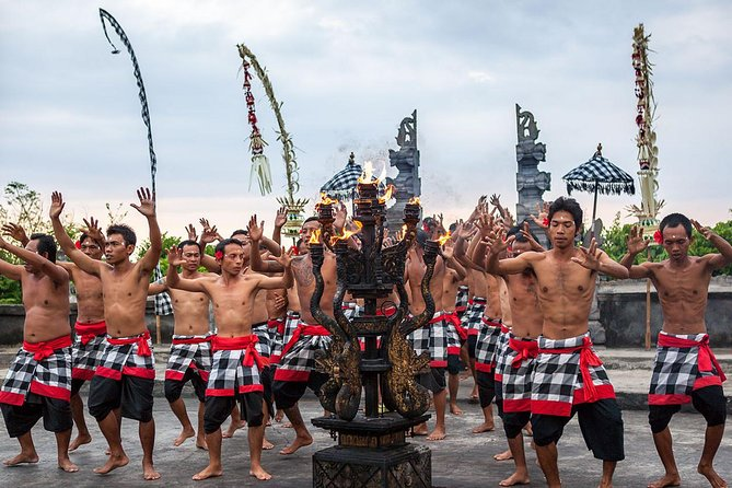 The Kecak dance is an enthralling traditional Balinese art which should be seen by all visitors. On this evening you will watch this unique performance at a cliff top temple followed by a barbeque seafood dinner under the stars.<br><br>After hotel pick up at around 3.30pm. you'll be taken to the famous cliff- hanging temple at Uluwatu. The temple is perched right on the edge of the cliff, about 70 metres above the crashing waves of the Indian Ocean. Just as the sun sets, the dramatic Kecak Dance begins. The performance is otherwise known as Ramayana Monkey Chant.<br><br>Wearing traditional checked cloth around their waists, the male dancers chant in unison while depicting a battle from the Ramayana. After the performance, drive to one of the beautiful beaches in Jimbaran for a barbeque seafood dinner in a beach 'warung', a casual, small restaurant. Here dine on a seafood platter including prawns, grilled fish, squid and clams. Try some kangkung, also known as Indonesian water spinach.