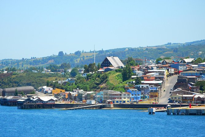 In the morning we will pick you up at your hotel in Puerto Varas for our drive to the island of Chiloé, which includes a nice 30 minute ferry crossing during which we can observe sea lions and maybe dolphins. <br><br>Once on the island, we continue south to the fishing village of Dalcahue. We will take our time to explore the beauties and culture of this beautiful small fishing village. You will learn a lot about how traditional life in Chiloe is and was during the last years. <br><br>We continue our journey to Castro, the capital of Chiloe, to observe the traditional palafitos (houses built on stilts along the shore) and visit the majestic wooden church (an UNESCO World Heritage Site). We will stroll through town and stop at the crafts market featuring wood and woolen products from the region. <br><br>In the late afternoon we will return to Puerto Varas driving along the eastern coastal road passing by several small fishing villages.
