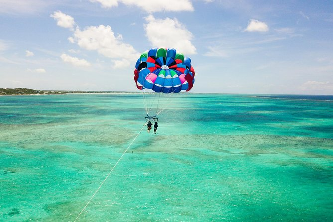 Grace Bay Watersports provides exciting parasailing tours in the Grace Bay beach area in Providenciales, Turks and Caicos. If you haven't done parasailing, there is no better place to enjoy it than Grace Bay. The view is breath taking and the experience is out-of this world. Call today to reserver your spot.<br><br>The maximum participants for this tour is 10.