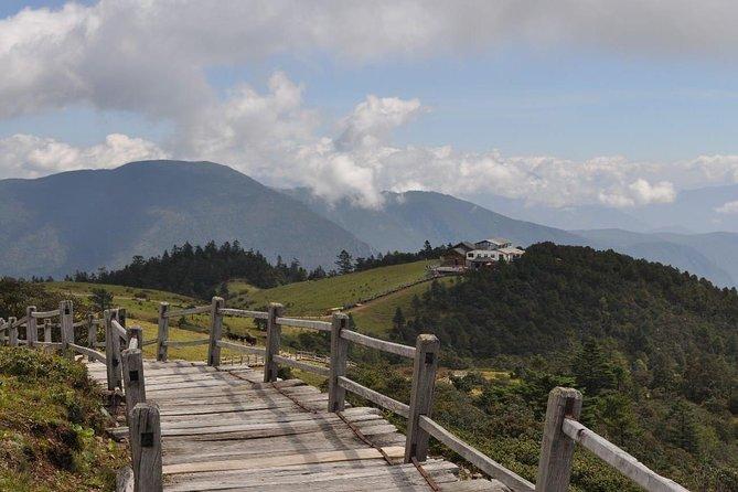Yak Meadow at Jade Dragon Snow Mountain and Shuhe Ancient Town from Lijiang, Lijiang, CHINA