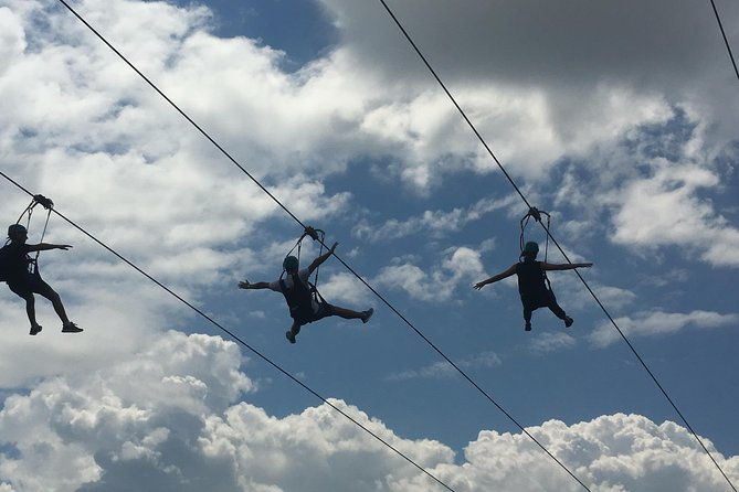 On four parallel ziplines that face the American and Canadian Horseshoe Falls, riders dangle from a precarious 67 metre (220 foot) high vantage point. Our fully-guided experience adds thrill to the breathtaking panorama as gravity floats riders 670 metres (2,200 feet), at speeds of 70+ kph (40+ mph), along the edge the vast Niagara river gorge to the Falls observation landing. Feel the incredible force of nature on your face!<br><br>Continue on to see Niagara River's Class 6 white-water rapids at the White Water Walk. The roar of the river provides a deceptive calmness, the perfect ambiance for your walk among the many viewing platforms that put you right at the river's edge.
