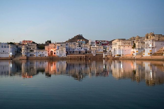 Pushkar is one of the oldest cities of India and is located in the Ajmer district of the Indian state Rajasthan. It is situated 14 km (8.7 mi) northwest of Ajmer at an average elevation of 510 m (1,670 ft) and is one of the five sacred dhams (pilgrimage site) for the Hindus. This beautiful town lies on the shore of Pushkar lake. This city is also known as the town of fairs and festivities. Infact, its specialty is the annual fair- Pushkar camel and livestock Fair, which is held in October to November for a period of seven days. The tour takes you to the Brahma Temple, Pushkar Lake, Savitri Mata temple and Dargah of Sufi Saint Khwaja Moinuddin Chisti. <br><br>A legacy of timeless architectural heritage makes Pushkar a fascinating city.