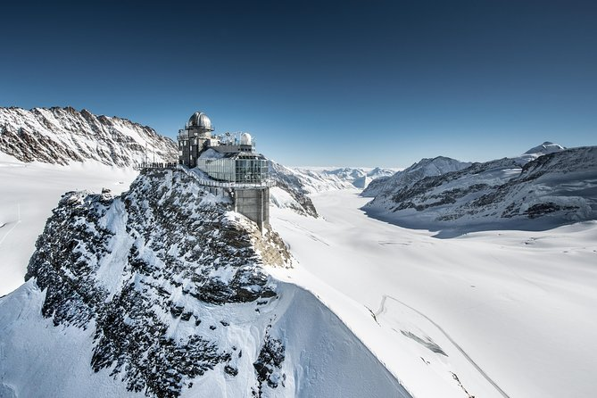 Travel to the top of Europe and admire the soaring peaks of the Swiss Alps on this 9.5-hour Jungfraujoch day trip from Lucerne. Take a scenic drive through high mountain passes to picturesque Lauterbrunnen with your guide. Board the cogwheel train and travel up to Kleine Scheidegg, beneath the famous Eiger North Face. Alight at the UNESCO World Heritage site of Jungfraujoch — Europe's highest railway station at a dizzying 11,333 feet (3,454 meters). Explore the Ice Palace and enjoy panoramic views over the mighty Aletsch Glacier from the observation terrace.