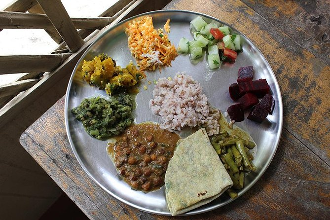 Enjoy a private and authentic cooking class in a local Mysore home with your host Anu, a local restauranteur. This is a perfect experience for anyone looking to connect with local culture over food. Meet Anu at her home and learn to cook a South Indian vegetarian lunch together in her kitchen. Your host is a sweet and friendly lady of Parsi ancestry married to a South Indian Brahmin - her menu spans several regions. Her food is renowned for being light, simple and incredibly fresh. Share a healthy and sumptuous thali lunch that includes dishes such as masala dosas (roasted rice crepes filled with spiced potatoes) served with a variety of chutneys, stuffed eggplant, sweet and sour cluster beans and sweet pumpkin delight. Your meal concludes with a homemade dessert. Weather permitting, Anu will serve lunch on her rooftop terrace. Leave with your belly full and memories that last a lifetime.