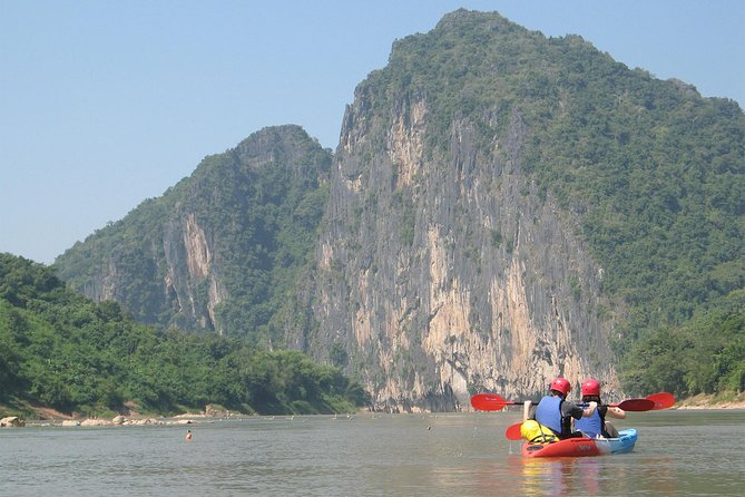 ・Spectacular kayaking on the Mekong and the Nam Ou rivers. You will find the diverse nature and landscapes of Luang Prabang<br><br>・Pak Ou Caves is located on the riverbank about 25km from Luang Prabang. The cave is very beautiful and filled with thousands of Buddha images and has long served as a pilgrimage site for all kinds of people, including members of the former royal family.<br><br>・Enjoy a delicious buffet lunch at the restaurant overlooking the Mekong river. <br><br>・The Kuang Si Falls is a three levelled waterfalls that begin in shallow pools atop a steep hillside and lead to the main fall with a 60 metres (200 ft) drop. This large cascade falls might just be the ultimate highlight of any trip to Laos.<br><br>・The tour date is reschedulable until 7 pm day before. Please contact us by email or message or visit Manifa Travel office (opposite of Villa Santi Hotel)