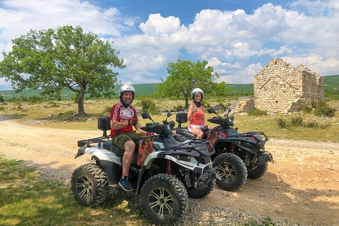 BEST ATV SAFARI TOUR THAT'S TWICE THE FUN ANYONE ELSE CAN OFFER YOU! Or just read some of our TripAdvisor Reviews! ;))<br>How do you improve your vacation? Add our bestseller ATV Tour! Enjoy more ATV time, more terrains, and more breathtaking views. One thing we're not short of in Dalmatia Inland is beautiful nature…so if you want more fun, enjoy with this fantastic off-road quad bike tour. Transfer from Split Prva Splitska Cesma and to same location is additional 10 EUR pp. Cool guides, helmets, gloves, bottle of water, lunch and photos are included in price. That is not all, if you want, after tour you can enjoy our swimming pool area for free if you came with your own car to our Base.