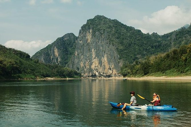 Head into the mountains and jungle outside of Luang Prabang to kayak down the Nam Khan River. During the rainy season you'll take an extended route on exciting, swifter water surrounded by lush vegetation. In the dry season, exposed banks allow us to stop for interesting sights along the way.