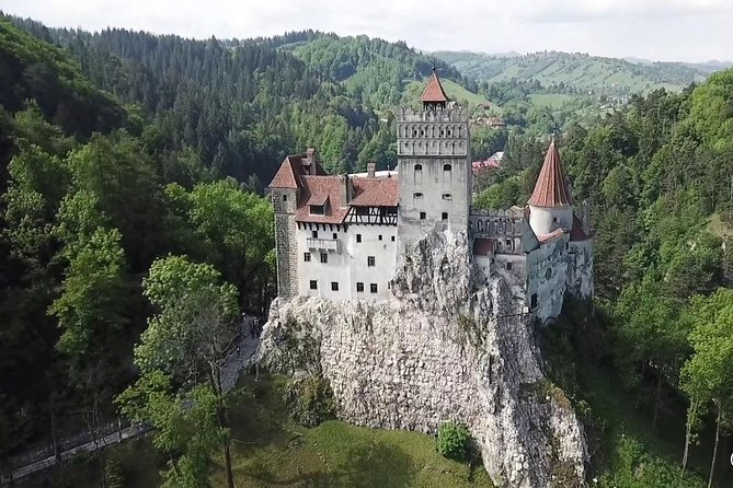 """Discover two of Transylvania's most stunning castles on this day-long adventure: Bran Castle, a 13th-century hilltop fortress known as """"Dracula's Castle,"""" and Peles Castle, a masterpiece of Neo-Renaissance architecture. On this day trip, you'll be ferried by climate-controlled minivan (max 8 persons) to both landmarks, and will also have the chance to wander the medieval city of Brasov."""