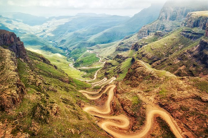 One of our most popular tours! The Sani Pass Lesotho 4x4 tour leaves from Durban and stops at the capital of KwaZulu-Natal, Pietermaritzburg. Your guide will give you a short tour of the city and visit Mahatma Gandhi's statue by Pietermaritzburg City Hall. Afterwards the tour moves towards the Drakensberg Mountains and up to the Sani Pass in Lesotho. Passport required. <br><br>You will see: <br> • Pietermaritzburg <br> • Mahatma Gandhi Statue, City Hall. <br> • Sani Pass in a Land Rover Defender 4x4 <br> • Visit local Bosotho village / homestead in Lesotho <br> • Highest Pub in Africa. <br>