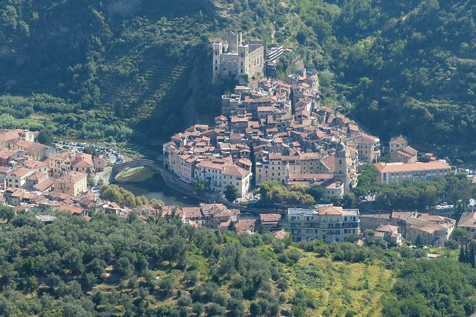 Venture into the inland area of Liguria hinterland to visit the beautiful medieval village of Dolceaqua and go for a wine tasting on this full day excursion.<br><br>Make a visit to a local wine producer to see the winery, do a wine tasting and enjoy sampling several local products. At the same time enjoy getting to know the landscapes of the interior of Liguria.<br><br>Afterwards, enjoy yourself like a true Italian and put your palate to the test with a meal full of traditional Ligurian flavors.<br><br>With your energy restored, it's time to visit one of the most beautiful medieval towns in the province. Let yourself be conquered by Dolceacqua with its narrow streets full of history and its beautiful old quarter that still retains many original features, such as cobblestone streets and its many alleys. <br><br>To end the day, we will enjoy some typical Dolceacqua sweets that are part of the gastronomic culture of the region.