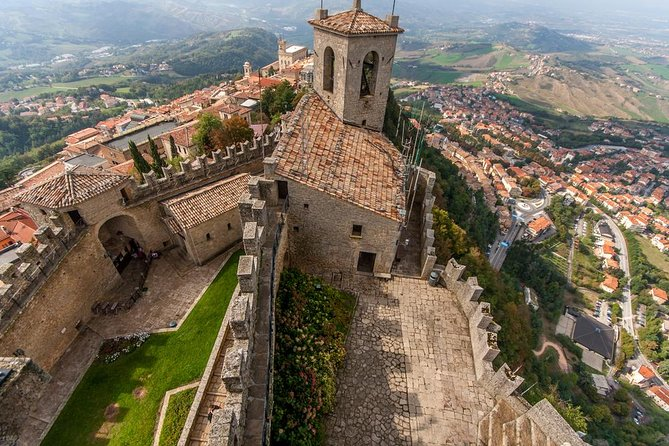 Discover San Marino, the fifth smallest and arguably the most curious independent country in the world, added to the UNESCO Heritage List in 2008.<br><br>Meet your guide at a central location to explore the historical heart of San Marino, the oldest republic in Europe.<br><br>The Unesco historical center of the republic is a living museum and visited by millions of tourists from across the world.<br><br>Set off to walk along the narrow streets and cobbled alleys, passing through squares and around churches. Visit the Piazza della Libertà, the main square, with its Town Hall and Basilica of St. Marino, and head up to the medieval First Tower, rising from the top of the hill.<br><br>You will need to climb lots of steps up to the tower, but you'll be rewarded with an extraordinary panoramic view of the Apennines Mountains and the Adriatic Sea from the top.<br><br>Despite its small size, San Marino also boasts thousands of stores and boutiques that make shopping here a real pleasure —especially as it's tax-free.<br><br>