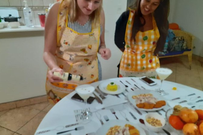 """Every day, from 11am to 14pm, from 15pm to 18pm (dinner class), from 18pm to 21pm, we will take you to our kitchen studio, located in cooperativa Víctor a Belaúnde LL-22-A yanahuara, where you will learn how to prepare traditional dishes with our most representative ingredients.<br>Aperitif: Passion fruit Sour,<br>Shake your own Pisco Sours and learn about the history behind our national cocktail.<br>Appetizer: Micuit Nikkei Style Tiradito,<br>Ceviche with a modern twist; Sashimi style fish marinated in a Japanese/Peruvian ponzu, avocados, cushuros and sweet potato puree.<br>Main dish: Causa Limeña.<br>Dessert: Chirimoya and exotic fruits parfait,<br>Have a taste of our best local fruits elegantly served as a parfait.<br>All dishes are seasoned with Maras pink salt<br>Vegetarian Options:<br>Fish would be replaced with """"Sweet cucumber"""", a local fruit.<br>Meat would be replaced with mushroom"""