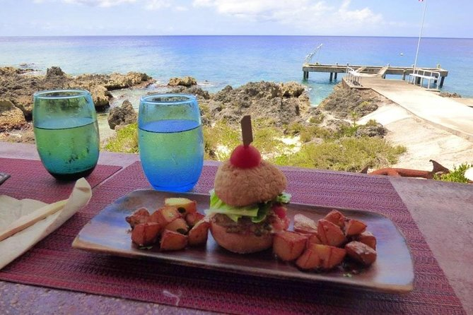 Enjoy a 3-hour food tasting & cultural tour that begins in the heart of the breathtaking George Town waterfront area and ends at the beautiful Camana Bay.You will enjoy only the best local food tastings as you learn historical and fun facts about the island's rich culture. On this group tour, you will have an exclusive opportunity to meet local chefs and owners. Transportation will be by bus, with minimal walking involved.The tour bus will take you back to the cruise ship terminal or hotel at the end of the tour.