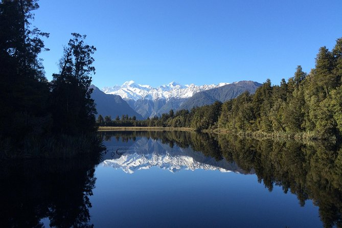Visit this iconic Lake which has just been named NZ's Great Short Walk. <br><br>World famous for it's stunning mirror-like reflections of our highest mountains - Mt Tasman and Mt Cook. Relaxed guided nature walking tour through an incredible primeval rainforest to magnificent reflections and mountain views. Departure times vary throughout the year as we like to give you the best possible chance of reflections (early evening). Your experienced guide will give you information on the local flora, fauna, history of the area, and how this lake relates to the surrounding glaciers and landscape. <br>* please note there is no option to go off track on this tour.<br>**Minimum group numbers apply.