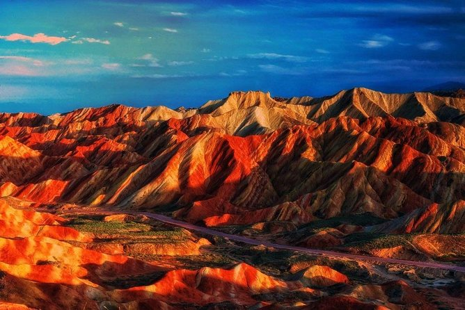 One of the most unique ways to experience Zhangye Danxia Geopark is during the sunset when the color variation changes continuously. Start your tour in the late afternoon, follow your tour guide to take the parks battery bus, gets you to experience the most photogenic Zhangye Danxia sunsets. Bring your camera, and if you like, your own beverages to enjoy this unique experience. This private day tour including English speaking tour guide, entrance fee, dinner, travel by private vehicle, Zhangye hotel pick up and drop off also included.
