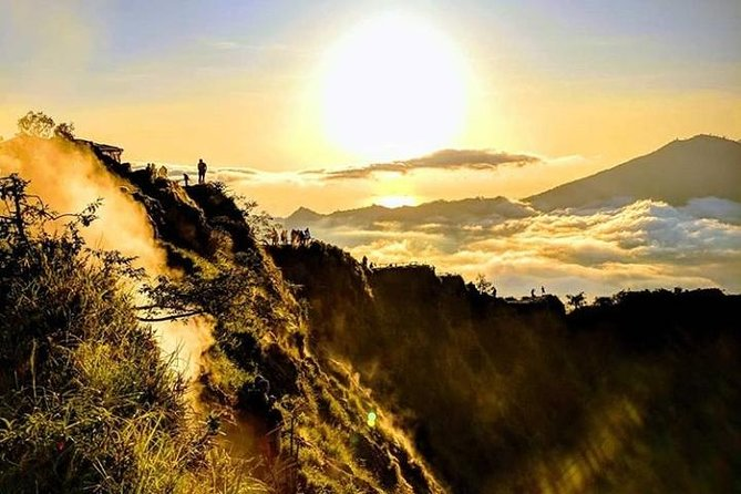 Batur Sunrise Trek and Hot Springs is one of our most popular tours you will enjoy the sunrise from the summit of Mount Batur in the morning, guided by an experienced local guide who will explain about the area. While enjoying the sunrise at the top you can enjoy breakfast by boiling eggs, bananas, by planting it in the sand and in 5 minutes it will ripen itself, after enjoying the beauty of the summit, you will prepare to go down the mountain, while enjoying the beauty of the mountain to continue the journey to the bath hot Spring.<br>The Natural Hot Spring has two natural hot tubs, the perfect place for all family members to relax completely.Heated deep in the earth, these air minerals are colorless and odorless.Natural Hot Spring is a favorite stop for all types of adventurers from the Kintamani area to tourists and health seekers The swimming pool will be the perfect place to swim after you trekking, you can canoe, or swim, to let go of fatigue and relax before returning to the hotel