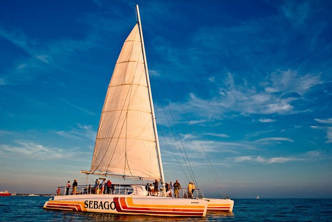 Admire an exquisitely painted sky during this premium sunset cruise in Key West. Create fantastic memories as you set sail on one of Sebago's modern sailing catamarans while sipping sparkling wine or your favorite cocktail and feasting on shrimp cocktail on your way to the best sunset viewing spot. You'll enjoy twilight views of the island as you watch the famous Key West sunset from the water. <br><br>Now featuring live music from local Key West Musicians!