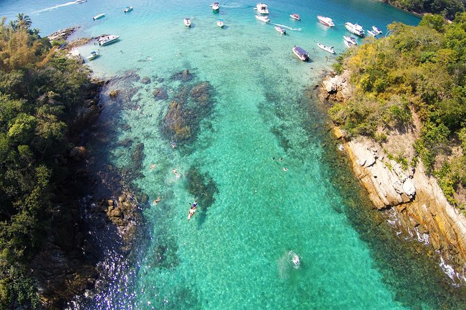 """These is one of the big classical tour on Ilha Grande<br>that you can't miss!<br><br>First stop at Blue Lagoon that is a calm transparent waters bay, perfect for snorkeling. <br>There we can snorkel surrounded by colored fish, watch sea stars as well as all the wide sea fauna diversity of Ilha Grande bay. <br><br>After swimming, we will follow to """"Freguesia de Santana"""" where Santana Church is located - built in 1796, it an important historical inheritance of Ilha Grande.<br><br>And we make the last stop for optional lunch at the beautiful Japariz Beach."""