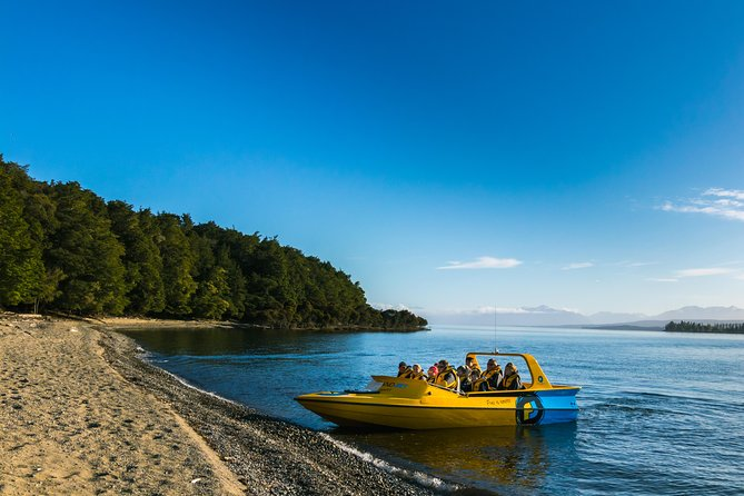"""The most scenic jet boat ride ever: see actual """"Lord of the Rings"""" film locations on the way down to the beautiful Lake Manapouri. On the way down the river you will get the chance to spot rainbow and brown trout. There is an amazing view around every river bend. The ride has a pinch of adrenalin and heaps of natural beauty. Lake Manapouri is amazing and you may not see another boat in sight.<br><br>Your start of part of the Kepler Track begins on disembarking from the boat at approximately 12:00 pm.<br><br>A leisurely guided walk begins through towering Beech trees and even taller Rimu trees. Our guide will share his/her knowledge with you; Native trees, ferns and the occasional Bellbirds, Tuis, friendly Fantails, Tomtits, Finches and Robins will keep your camera clicking.<br><br>The hike concludes at the large suspension bridge at Rainbow Reach where your transport awaits to take you back to Te Anau"""