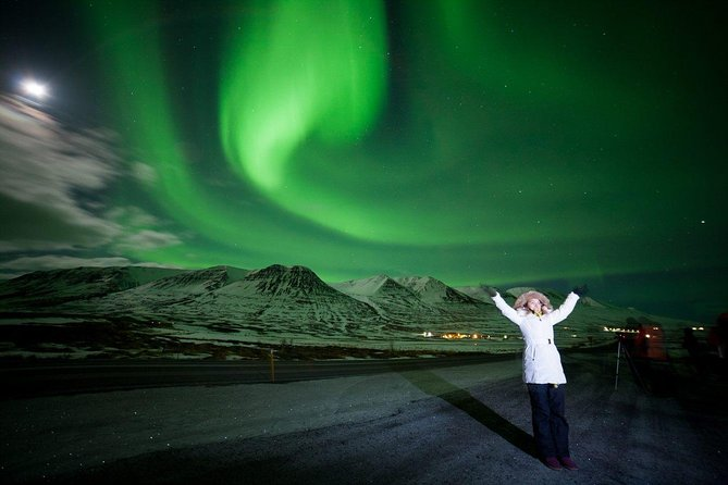 View the spectacular Northern Lights on a 2.5-hour guided coach tour from Akureyri. Leave the electric glow of the city behind and venture into Iceland's countryside to seek out the Aurora Borealis, one of nature's most wondrous phenomena. As you gaze up at the shimmering night sky, hear more about the science behind this occurrence from your knowledgeable guide.