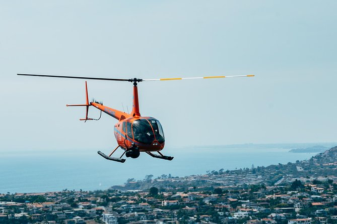 While not quite as mysterious as the Bermuda Triangle, the OC Triangle is far cooler! For approximately 20-25 minutes, fly over the classic OC beaches without breaking the bank! Our shortest tour will fly you over Huntington Beach Pier and Newport Harbor for the perfect taste of beach life. <br><br>Choose the Deluxe Tour in the Robinson R66 Turbine helicopter (for 2-4 people) and get in-flight snacks, a #FLYROGUE t-shirt, your own set of Rogue Aviation wings and #FLYROGUE stickers included for each passenger!