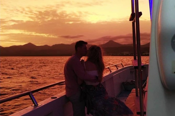 New for 2019! Chilled Champagne, Cocktails smooth relaxing music and the best sunset you will ever likely see in your life! <br><br>Step aboard our completely refurbished 17 Metre Motor Catamaran and relax in our luxury bean bags on on our sun deck or on our VIP area watching out for Dolphins and Pilot Whales. Listen to the smooth relaxing Spanish Guitar and Chillout House music while we cruise into the sunset We are a very friendly Motor Catamaran and small family business offering the very best service and we can cater for up to 46 people on any one trip. We do not overcrowd our boat and offer an all inclusive experience, meaning free flowing beer, sangria and soft drinks plus a champagne welcome, you are able to purchase spirits & more champagne on the trip if you wish! The price includes a bus to and from your home resort including Costa Teguise, Puerto Del Carmen and Playa Blanca. <br>*Please note you will be required to remove your footwear to enter the boat*